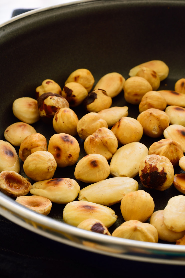 Toasted nuts in a pan.